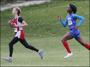 Bowsher's Shauna Plath stays in front of Woodward's Tymeshia Childress for most of the race, but loses her lead in the end during the City League girls cross country race at Collins Park Golf Course in Toledo, Ohio. Plath came in 2nd and Childress won the race.
