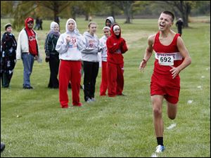 Bowsher's Tom Heckman wins the City League boys cross country race at Collins Park Golf Course in Toledo, Ohio.