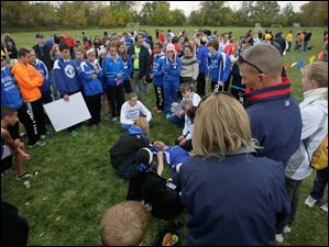 Kohl Taberner, of Springfield, collapsed on the ground for about 12 minutes after finishing runner up in the race.