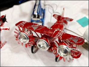 Airplanes made out of soda cans make up the majority of the Luckey's Airplanes booth.