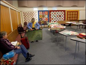 Quilters of Sylvania First United Methodist prepare to pack up their things as their annual show comes to an end.