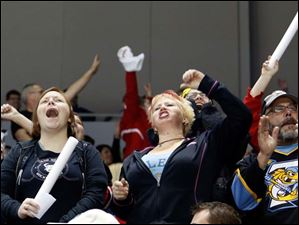 Toledo Walleye fans cheer Saturday at the Huntington Center in Toledo.