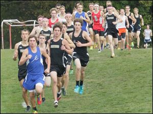Springfield High School's Kohl Taberner in the lead about mid-way in the race.