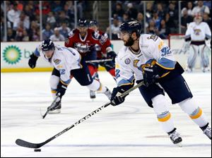 Toledo Walleye's  Cody Lampl moves the puck against Kalamazoo.