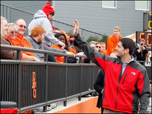 Ryan waves to fans before the game.