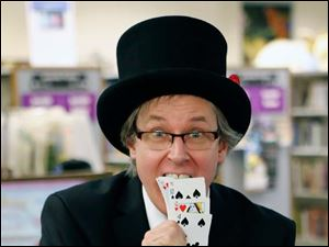 Magician Andrew Martin performs another card trick.