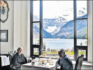 S. Amjad Hussain, right, with friend Hidayat Ullah at Lake Louise.