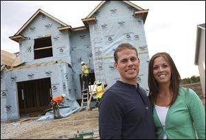 Mike and Ann Jeweson, both in the twenties, are taking advantage of low interest rates to make the four-bedroom home under construction behind them their first home.
