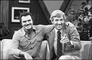 "Actor and talk show host Gary Collins, right, reacts to a joke told on the set of ""Hour Magazine"" in Los Angeles during a break in taping  Wednesday, July 30, 1981 with guest Burt Reynolds."