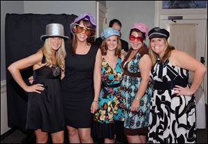 Wedding guests are ready for a trip into a photo booth sponsored by Exceptional Receptions in Binghamton, New York. Couples are starting to include photo booths as an activity for the guests during wedding receptions. Wedding planners say the activities make the evening more fun.