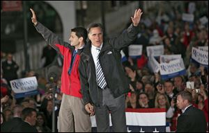 Republican Presidential candidate Mitt Romney and Republican Vice Presidential candidate Paul Ryan wave goodbye Friday after a victory rally held in the town square in Lancaster.