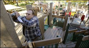 Volunteer Kevin Smith helps build Imagination Kingdom. The work will be done, and the park opened, on Sunday.