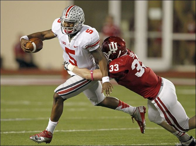 Ohio State quarterback Braxton Miller is taken down for a loss by Indiana defensive end Zack Shaw during the first half Saturday in Bloomington, Ind.