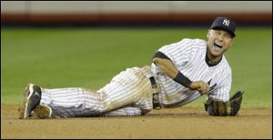 New York Yankees shortstop Derek Jeter reacts after breaking his ankle in the 12th inning.