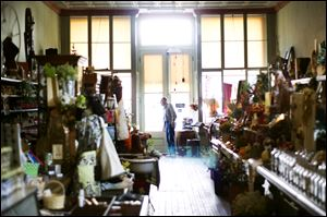 A customer browses through Beeker's General Store in downtown Pemberville.