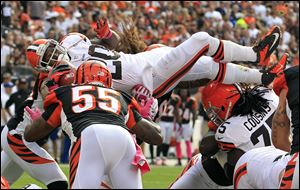 Cleveland Browns running back Montario Hardesty (20) leaps for a 1-yard touchdown against the Cincinnati Bengals in the fourth quarter of an NFL football game Sunday.