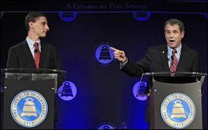 U.S. Sen. Sherrod Brown, D-Ohio, right, debates Republican challenger, Ohio state treasurer Josh Mandel, at the City Club in Cleveland.