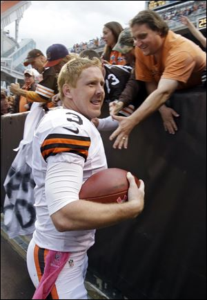 Cleveland Browns quarterback Brandon Weeden celebrates with fans after an NFL football game against the Cincinnati Benga