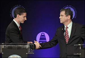 U.S. Sen. Sherrod Brown (D., Ohio), right, shakes hands with Republican challenger, Ohio state treasurer Josh Mandel, after their debate at the City Club in Cleveland.