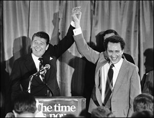 Ronald Reagan, the GOP presidential candidate in 1980, holds up U.S. Senate candidate Arlen Specter's hand at a fund-raiser for Mr. Specter in 1980.