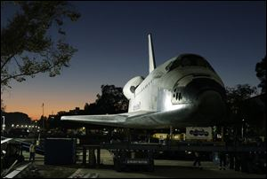 The space shuttle Endeavour is moved to the hangar in the California Science Center for its last stop on Sunday, in Los Angeles. Endeavour arrived at the museum after a 12-mile parade with thousands of onlookers ending with a greeting party of city leaders and other dignitaries.