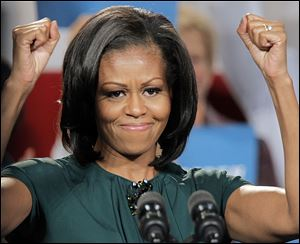 First lady Michelle Obama reacts to the cheers as she campaigns for her husband, President Barack Obama.