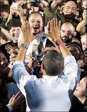 President Obama greets a girl in the audience at  Ohio University. The visit marked Mr. Obama's first campaign stop in southeast Ohio.