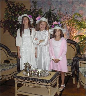 Shaylin, Shannyn, and Shanara Jenkins are dressed for the Tea and Hat affair.