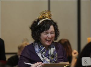 Joy Forrester one of the judges at the spelling bee shows her enthusiasm. Thirty-six teams participate in the 25th annual Blade Corporate & Community Spelling Bee to benefit Read For Literacy.
