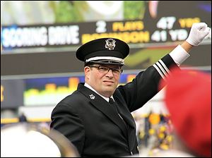 Jon Waters,  who was fired last month as director of the Ohio State University marching band, said he wants his old job back.