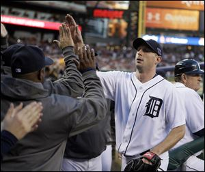 Detroit's Max Scherzer is congratulated by teammates after being taken out of the game in the sixth inning Wednesday at Comerica Park.