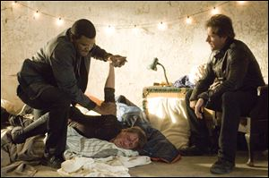 "Edward Burns, right, and Tyler Perry in a scene from ""Alex Cross."""