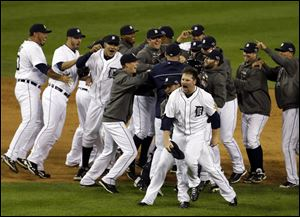 Tigers pitcher Phil Coke and teammates celebrate after winning Game 4 in Detroit.