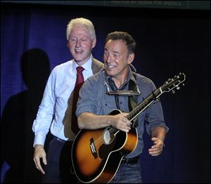 Former president Bill Clinton, left,  introduces Bruce Springsteen at a Democratic rally at Tri-C Western Campus in Parma on Thursday.