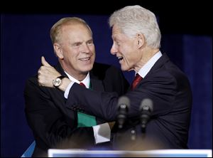 Former President Bill Clinton gives a thumbs up after being introduced by former Ohio Gov. Ted Strickland.