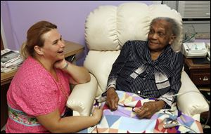 Audrey Lott, who turns 109 today, talks with nurse Annette Krintzline. Lott is the oldest resident Tiffin's St. Francis nursing home has ever had.