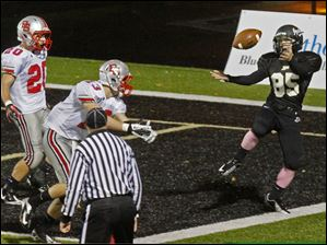 Perrysburg's senior wide receiver Jimmy Reddick narrowly misses the touchdown.
