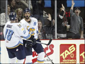 Walleye players Randy Rowe, 18, and Wes O'Neill, 5, celebrate O'Neill's goal against the Cincinnati Cyclones.