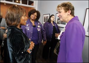 Actress Alfre Woodard, left, speaks with SEIU President Mary Kay Henry, right, prior to a womenÕs roundtable at Petit Fours Bakery in Toledo.