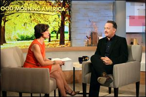 This image released by ABC shows actor Tom Hanks during an interview segment with Elizabeth Vargas on