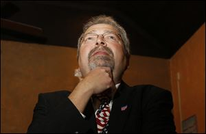 Maumee mayor Tim Wagener watches early voting results during an election night poll watching party in 2011.