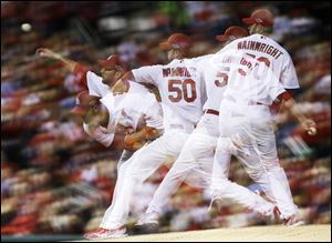 Cardinals starting pitcher Adam Wainwright pitches in a multiple-exposure sequence in fifth inning Thursday during Game 4 of the National League Championship Series between the St. Louis Cardinals and the San Francisco Giants.