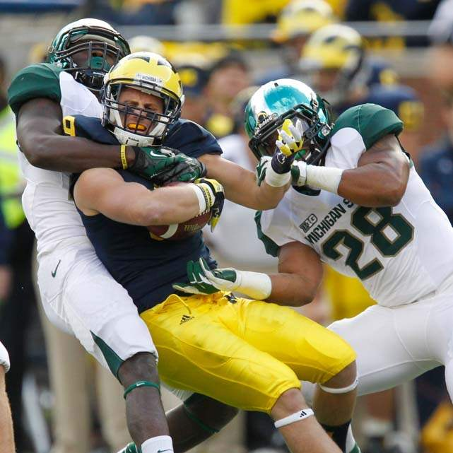 Michigan-Dileo-tackled