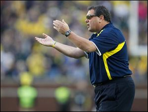 SPT michigan21 University of Michigan head coach Brady Hoke urges on his team against Michigan State University during the fourth quarter at Michigan Stadium in Ann Arbor, Saturday, October 20, 2012.  The Blade/Andy Morrison