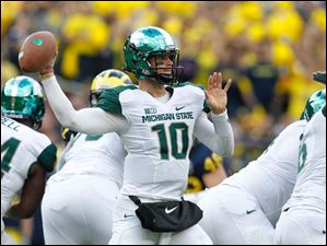 Michigan State quarterback Andrew Maxwell throws during the first quarter.