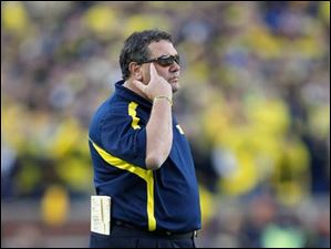 Michigan head coach Brady Hoke tells his players to think after they were penalized for pass interference and roughing the passer on the same play in the fourth quarter.