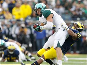 Michigan State's Max Bullough intercepts a pass as he's tackled by Michigan receiver Jeremy Gallon.