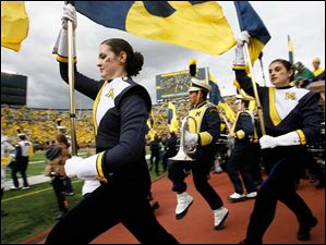 The University of Michigan marching band takes the field before the game.