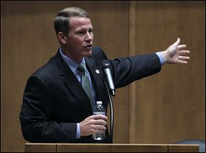 Ohio Secretary of State Jon Husted gives the keynote address during a public symposium Friday at the University of Toledo Law School.