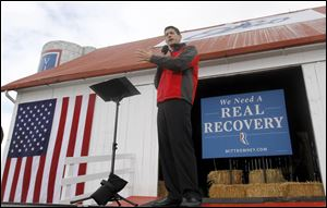 Republican vice presidential candidate, Rep. Paul Ryan, R-Wis. gestures while speaking at a campaign rally Saturday at the Valley View Campgrounds in Belmont, Ohio.